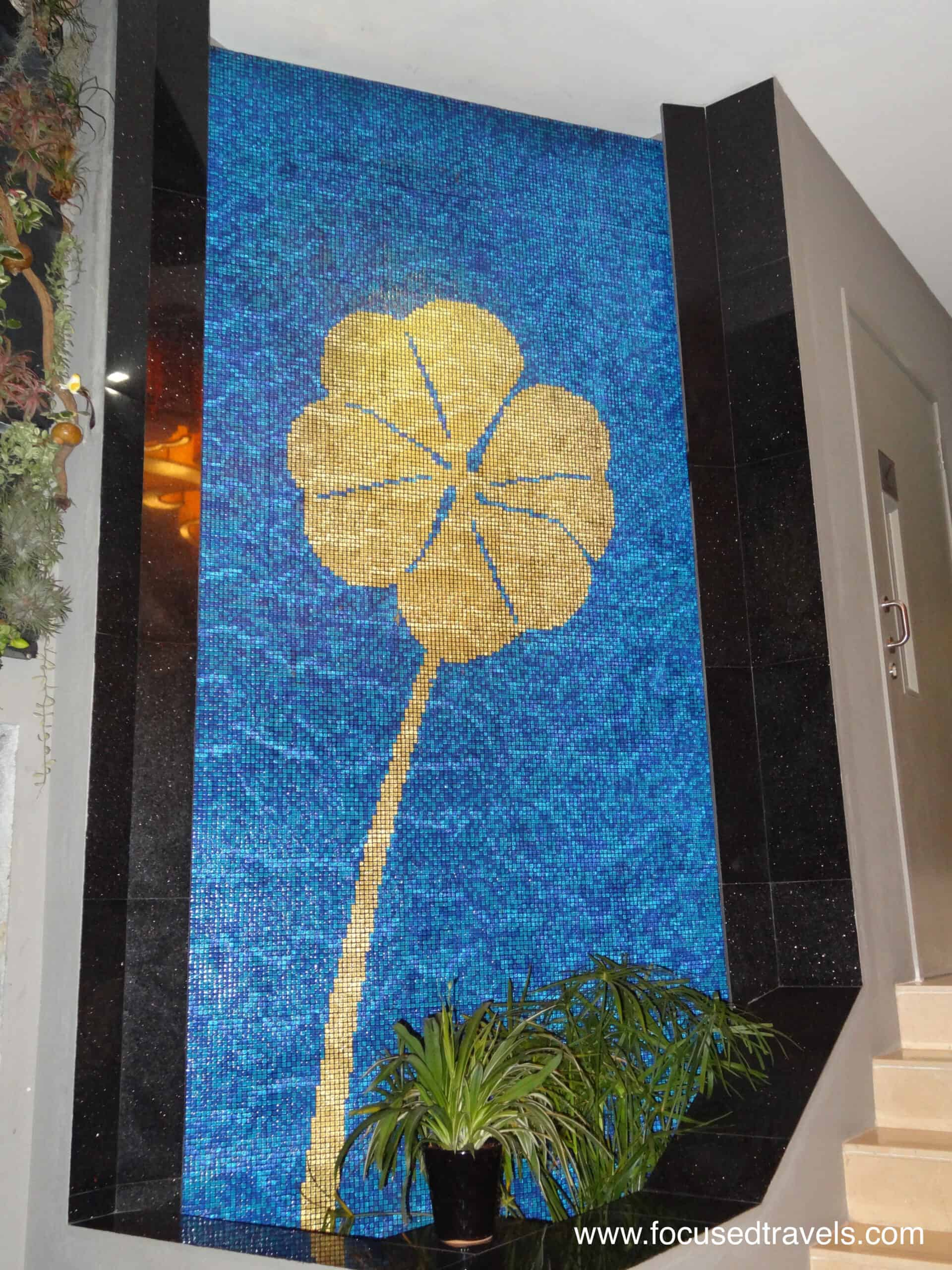Hotel Clover - artwork next to the steps leading to reception