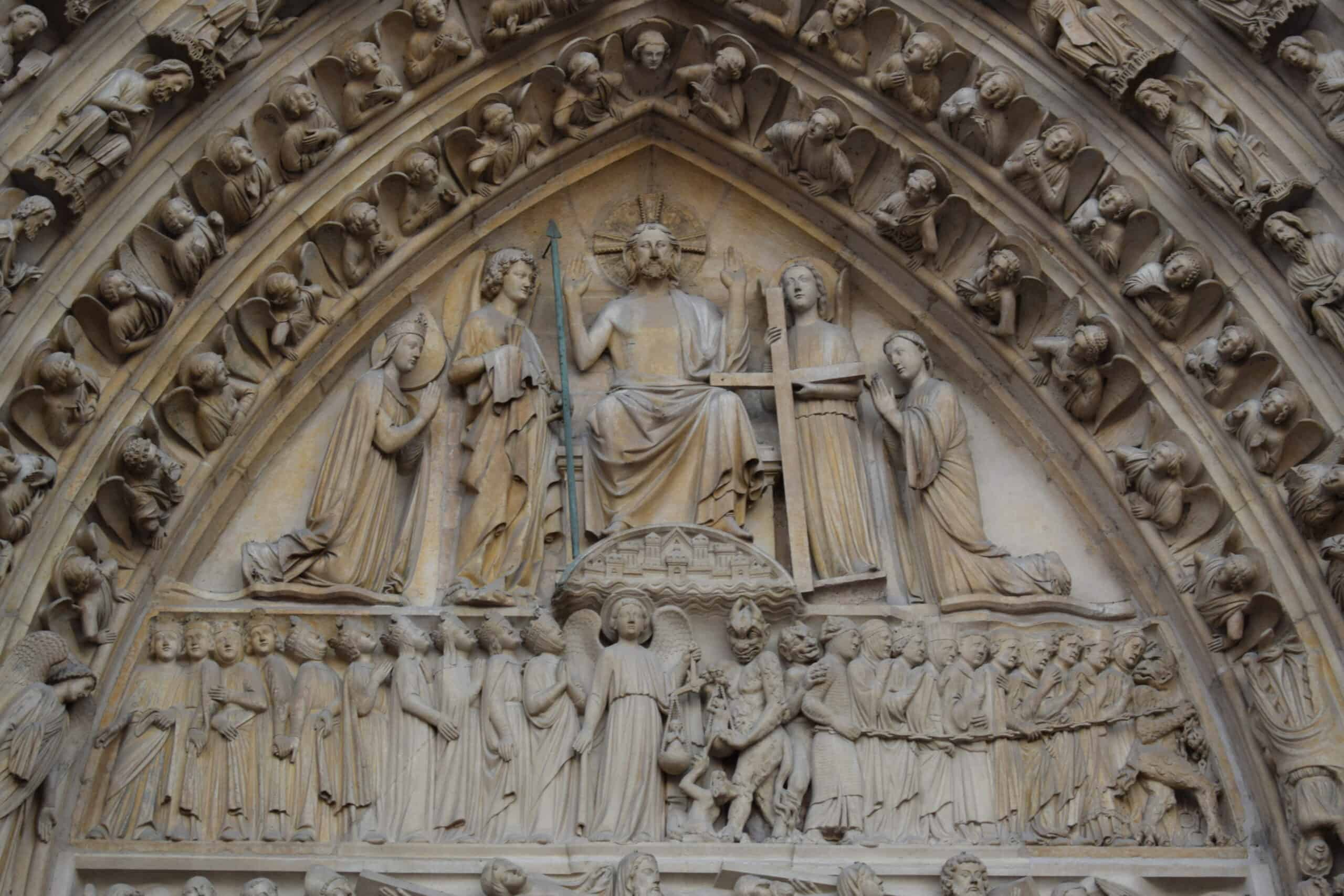 Carvings on the arches of the Notre Dame Cathedral - free audio walking tour of Paris